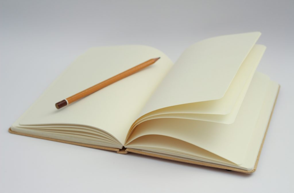 Empty notebook and pencil